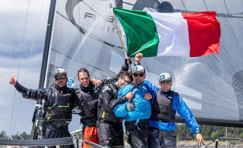 Andrea-Racchelli's-Altea-crew-celebrate-victory---Zerogradinord/IM24CA-pic