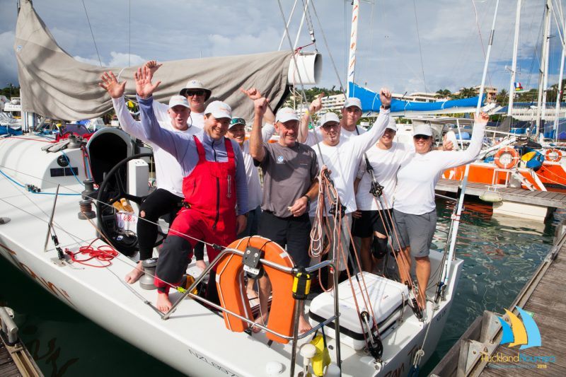 The crew on Ran Tan II celebrate their line honours victory. Photo: Auckland Noumea Yacht Race.
