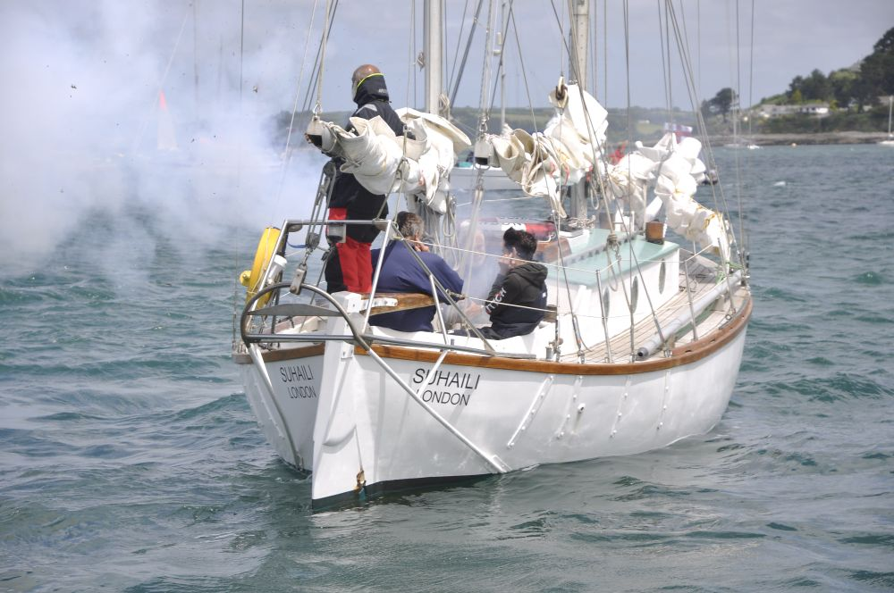 Sir Robin Knox-Johnston fires the start canon from SUHAILI to set the 2018 Golden Globe Race fleet off to Les Sables d'Olonne. Photo PPL Agency.