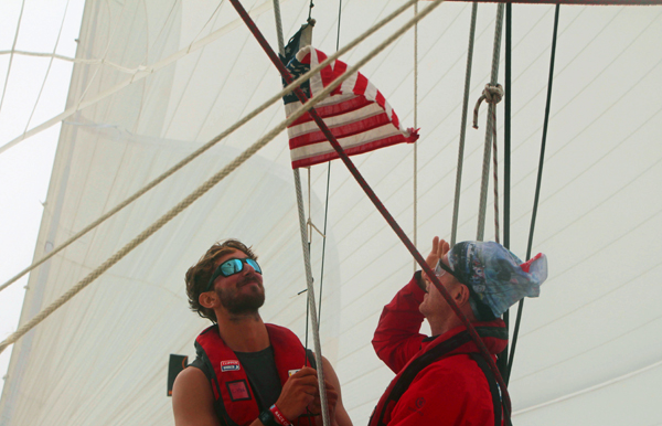 Chris Goodwin and Duffy Drum hoist-American-courtsey-flag