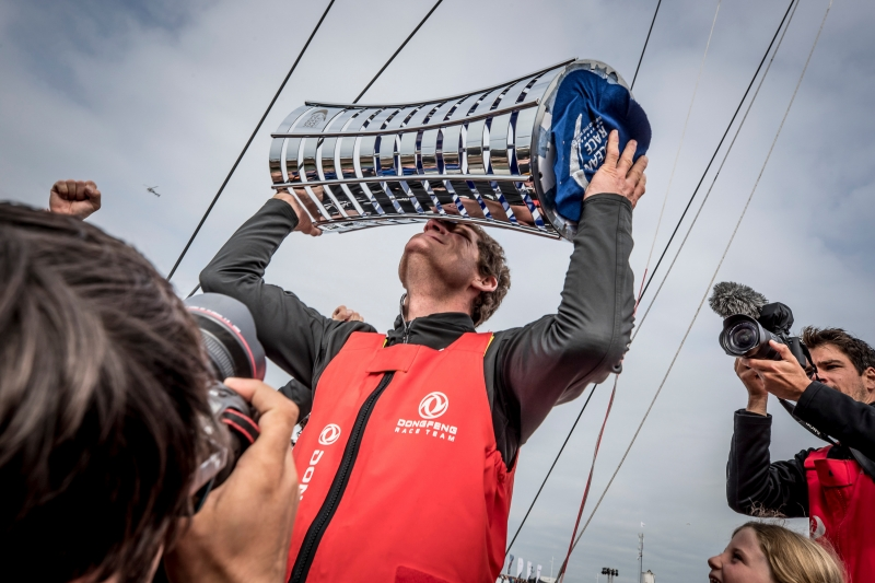 Charles Caudrelier celebrates with the Volvo Ocean Race trophy. Leg 11 from Gothenburg to The Hague. Finish at The Hague. 24 June