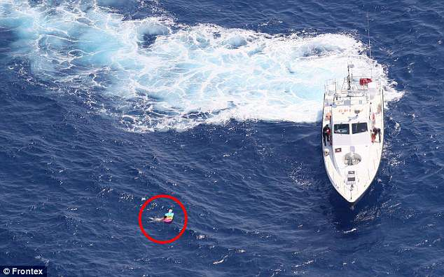 Dramatic pictures show the moment a Russian holidaymaker (circled) was rescued seven miles off the coast of Crete