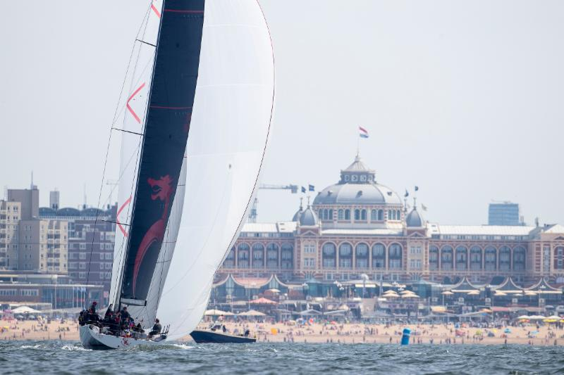 Beau Geste heads at their gold medal finish with beachgoers enjoying another fabulous day © Sander van der Borch.