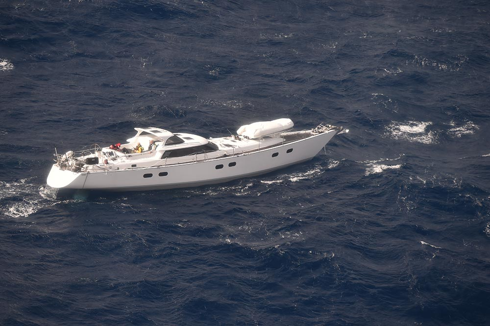 Surviving crew of the sailing yacht Platino await rescue. Photo NZDF.