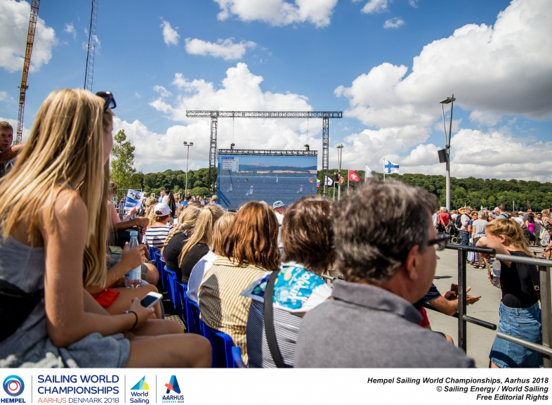 Spectators watch the racing on the big screen at Aarhus. Photo Sailing Energy/World Sailing.