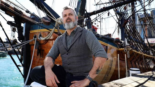 Marine archaeologist James Hunter with a replica Endeavour at the Australian National Maritime Museum in Sydney. Picture: James Croucher.
