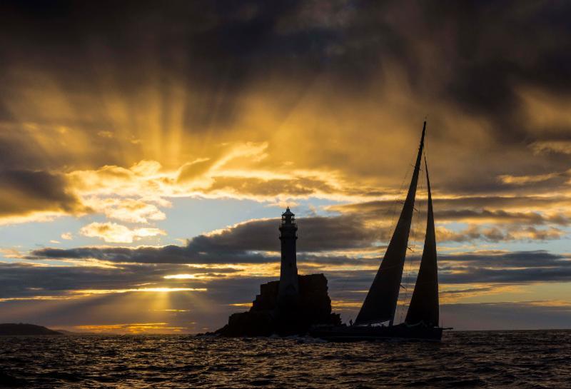 A spectacular sunrise as the 115ft superyacht Nikata rounded the Fastnet Rock at 06:41:05 on Tuesday morning. © Rolex/Kurt Arrigo.