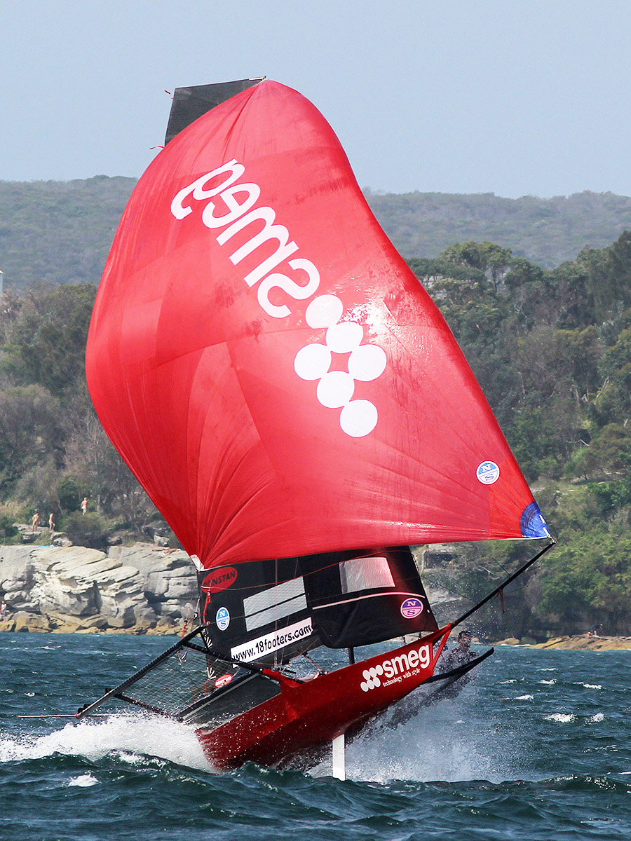 Smeg flies on her way to victory in Race 4 of the Spring Championship on Sydney Harbour. Photo Michael Chittenden/18 Footers League.
