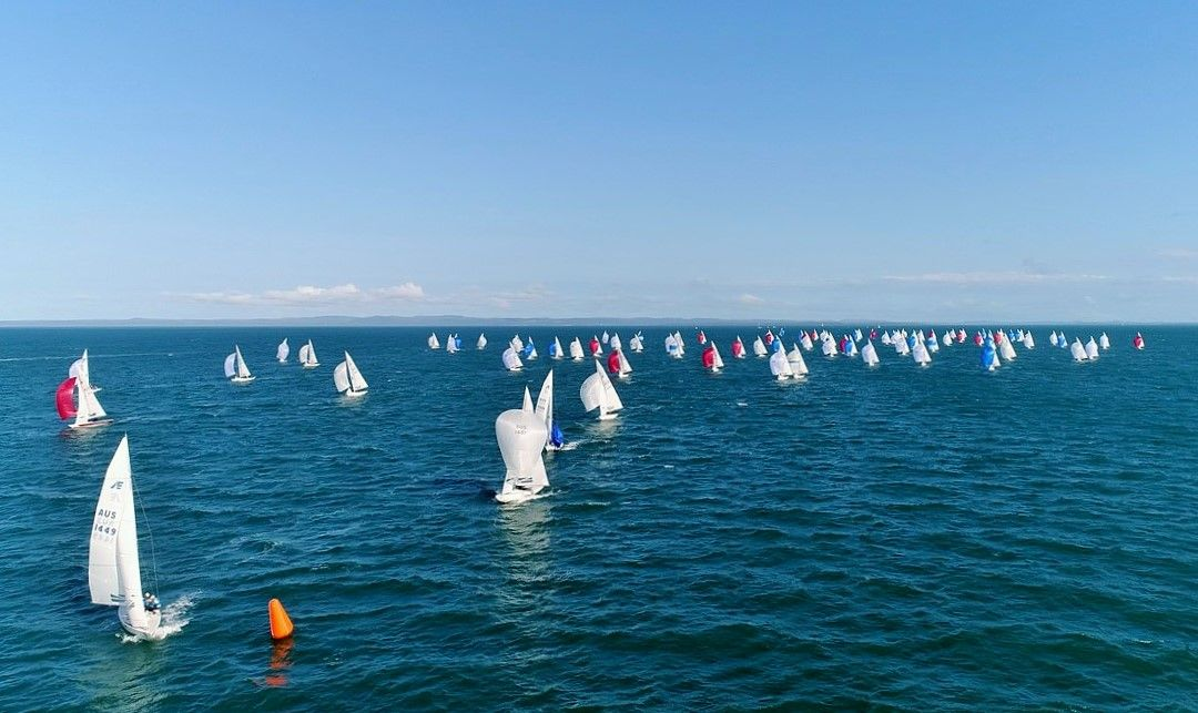 Martin Hill and team lead around the gate on day 1 of Etchells Worlds 2018 - Nic Douglass