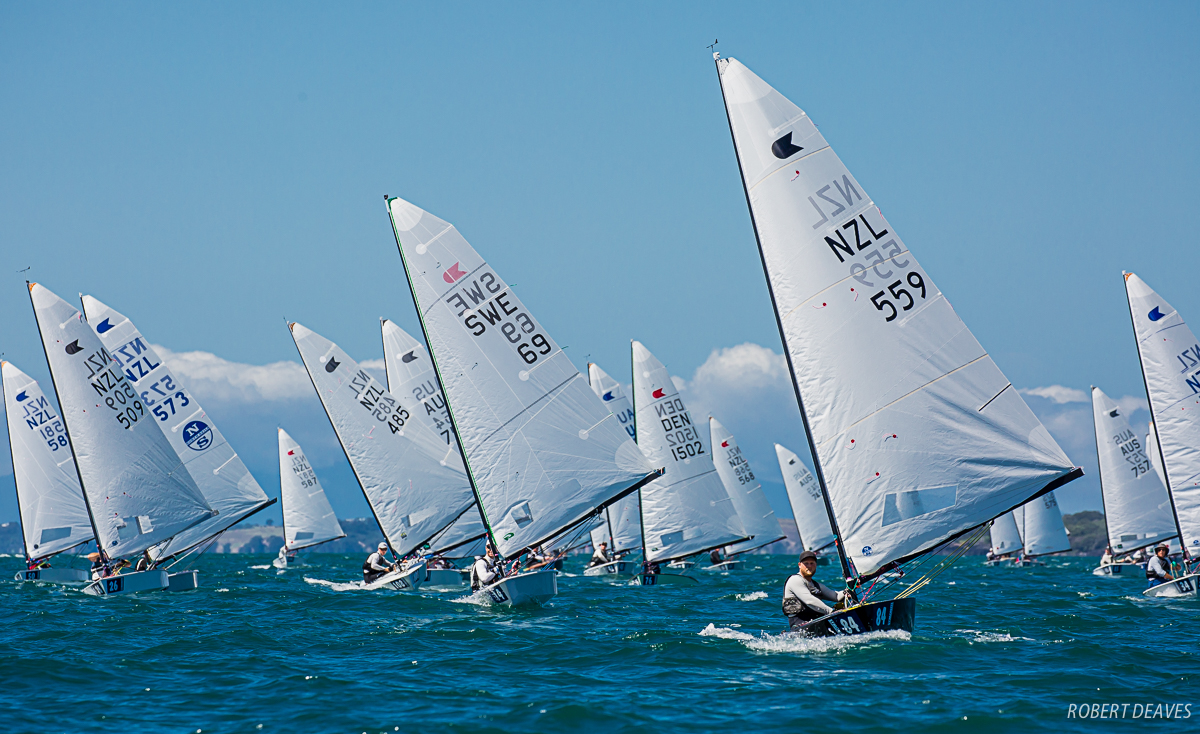 Race 6 of the OK Dinghy Worlds in Auckland. Photo Robert Deaves.