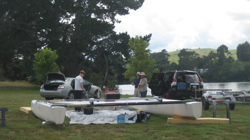Team New Zealand crew members with the test hulls for the first foiling catamaran. Photo ETNZ.