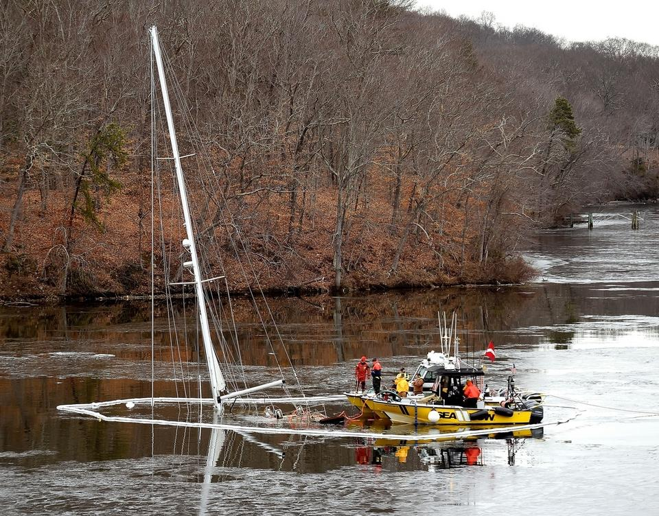 Salvage crews work Wednesday