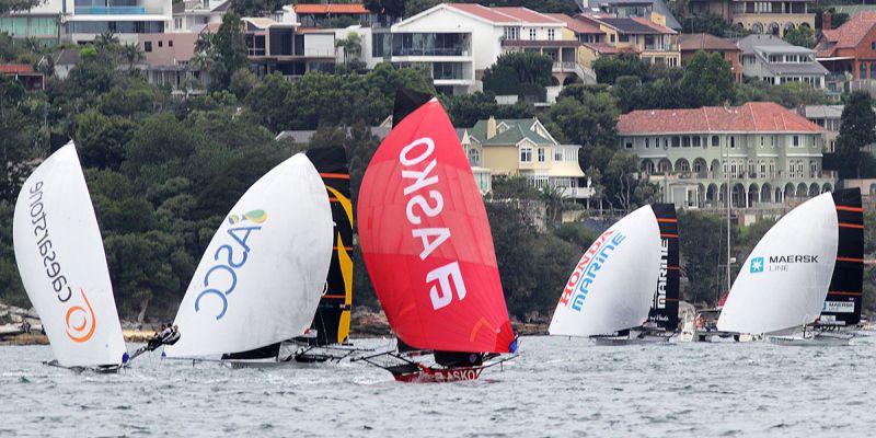 Asko Appliances leads the fleet down the first spinnaker run in Race 6.