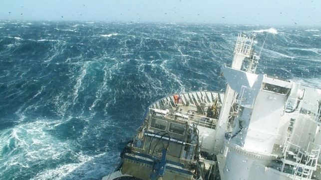 A research vessel ploughs through the waves