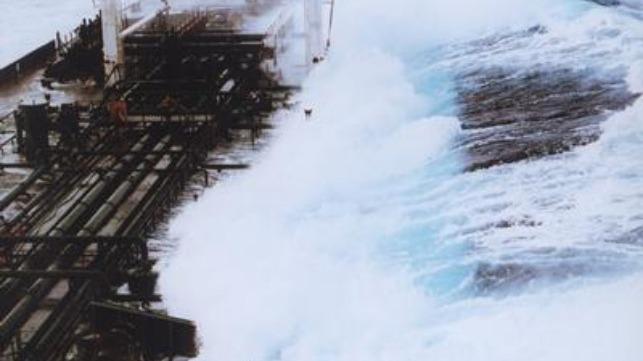 60-foot wave hitting tanker off Alaska. Credit: Captain Roger Wilson/NOAA.