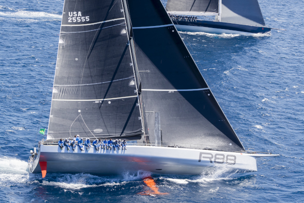 Rambler 88 and Magic Carpet 3 power upwind to the first turning mark at La Formigue. Photo: ROLEX / Carlo Borlenghi