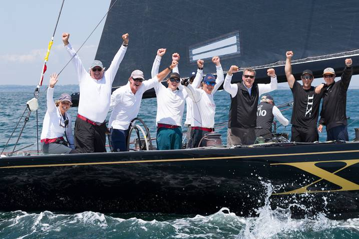 Challenge XII (KA-10) owner/helmsman Jack LeFort (second from left) celebrates victory and a World Championship title after today's final race of the 2019 12 Metre World Championship