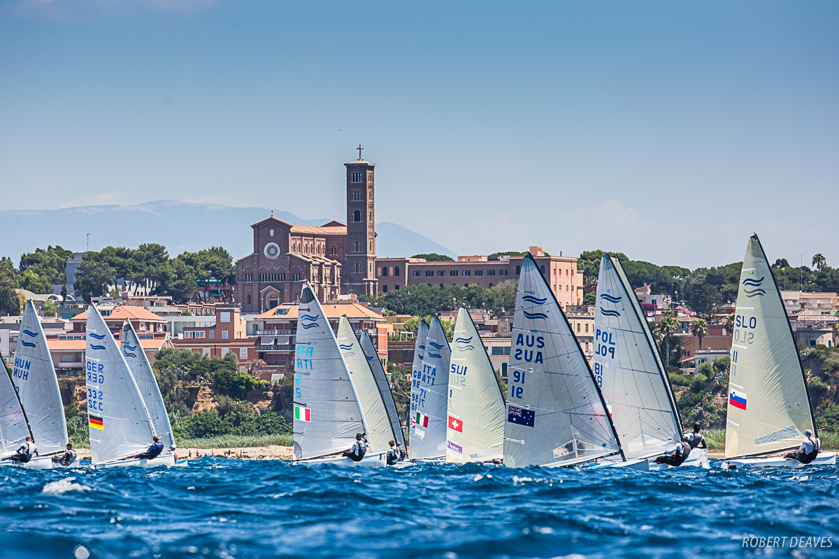 Race 4 off the Anzio shoreline at the Finn Silver Cup 2019. Photo Robert Deaves.