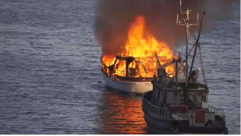A boat burned for some time before sinking in Long Harbour off Salt Spring Island Wed.
