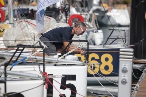 Last minute repairs before the fleet leaves on the second leg. Photo © Christophe Breschi.