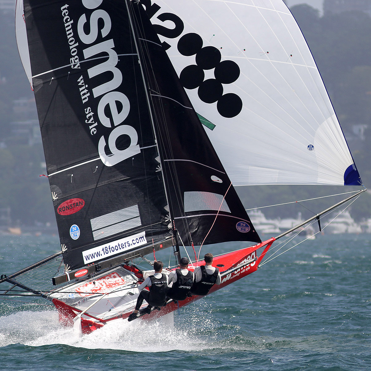 Brilliant exhibition of power sailing downwind by the Smeg crew. Photo Michael Chittenden/18 Footers.