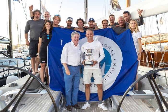 IMA Secretary General Andrew McIrvine presents Wallyño's Benoît de Froidmont and crew with the IMA Mediterranean Maxi Inshore Challenge trophy. Photo: Gianfranco Forza.