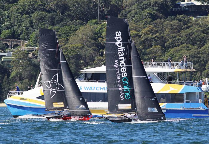 The two leaders set out on the final windward leg of the course. Photo 18 Footers league.