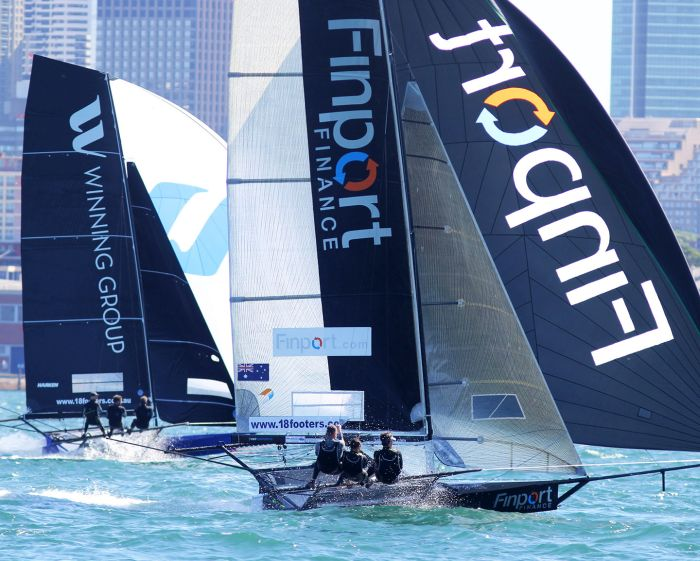 Only a few secs separated Winning Group and Finport Finance on the second spinnaker run to the bottom mark. Photo 18 Footers League.