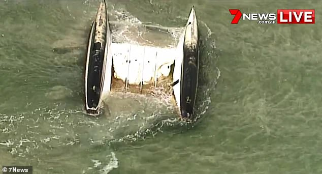 The overturned catamaran after five months in the water. Photo Channel 7 helicopter.