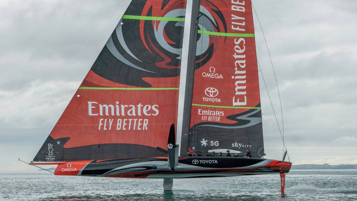 Team New Zealand foil past a 1995 America's Cup boat while training in Auckland.