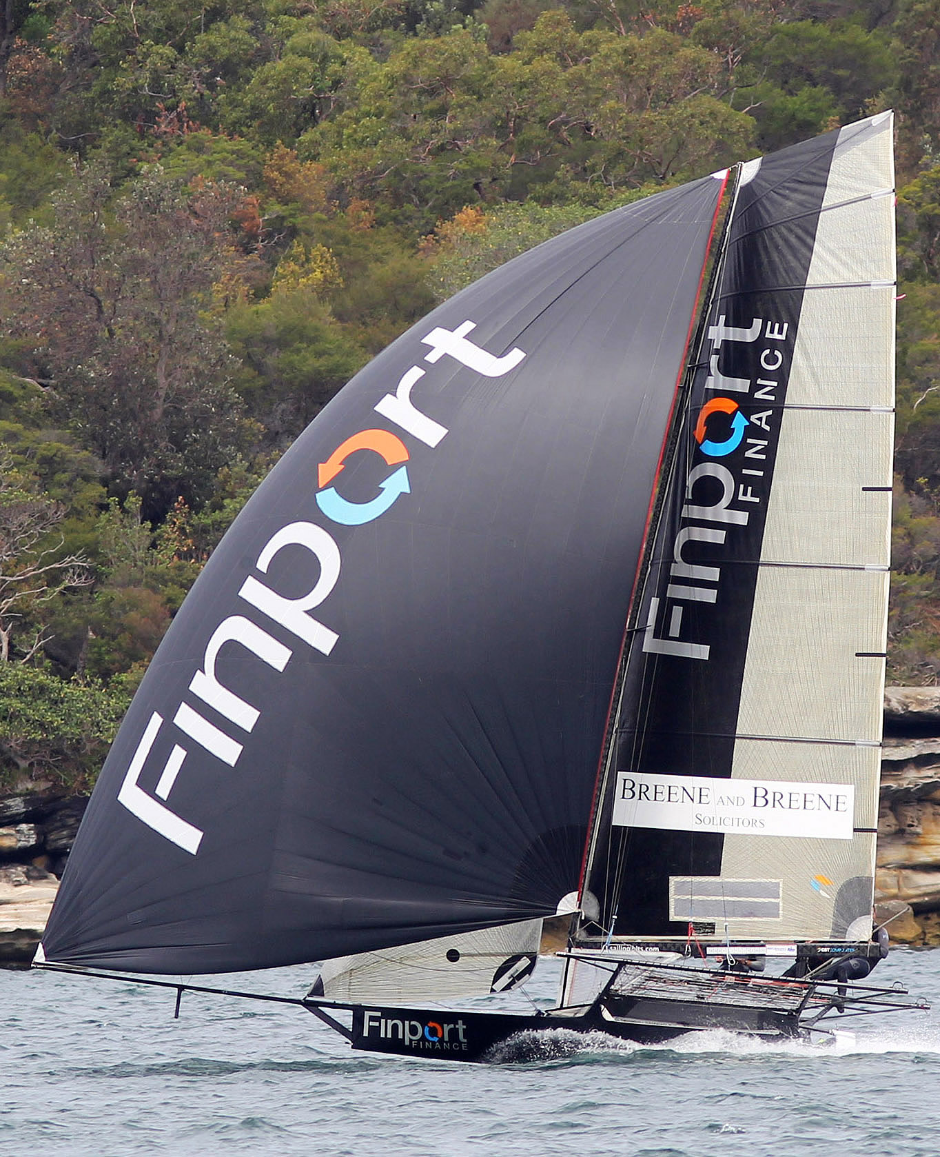 Finport Finance cruises to victory in Race 1 of the Australian 18ft Skiff Championship on Sydney Harbour toda