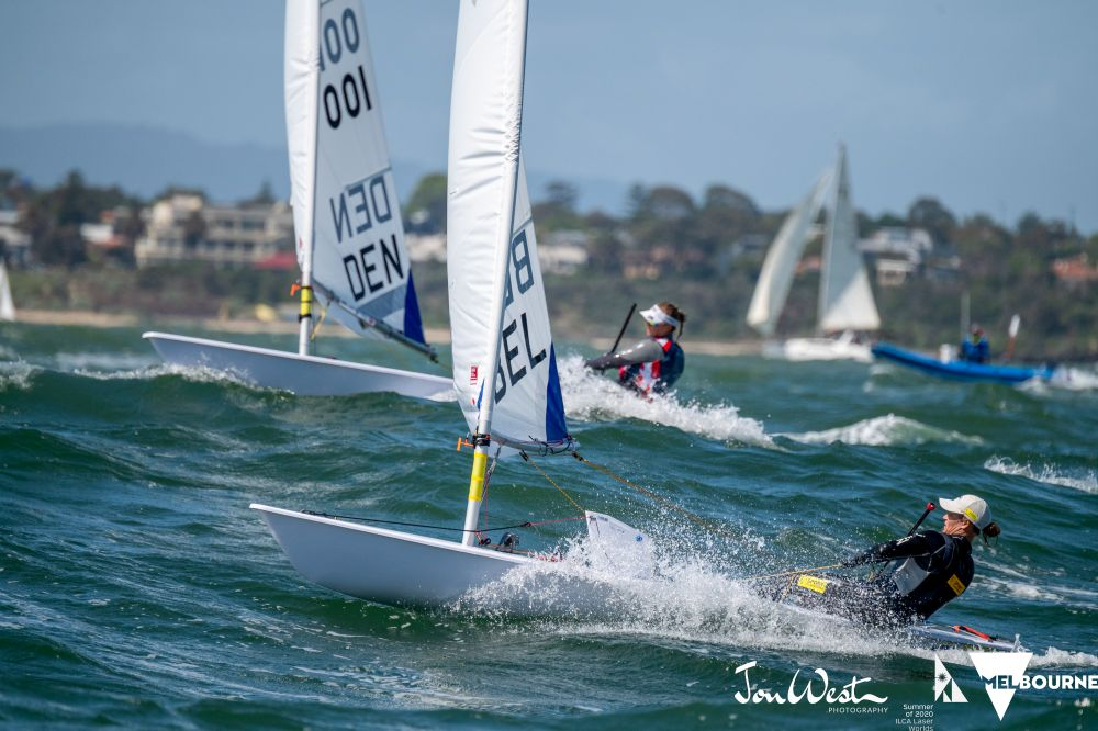 Tight at the top. Emma Plasschaert (BEL) and Anne-Marie Rindom (DEN) do battle on the fourth day of the Laser Radial World Championships at Sandringham. Photo Jon West Photography.