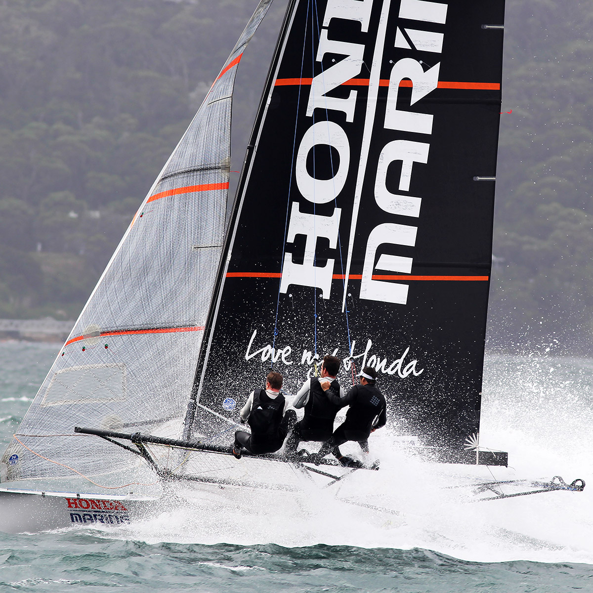 Honda Marine accelerates after a mark rounding off Shark Island in a SE breeze. Photo Michael Chittenden.