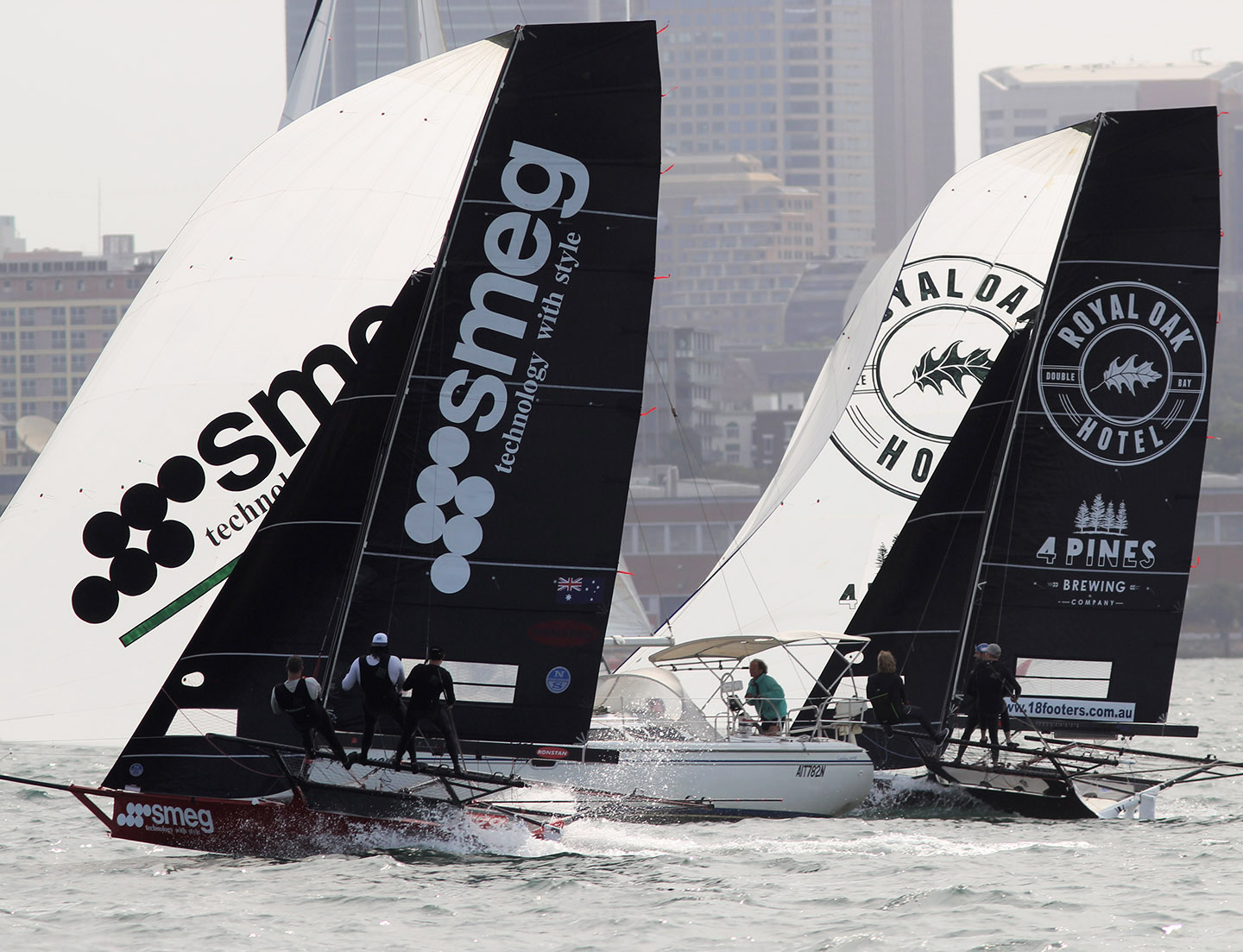 A-yacht-is-caught-in-an-18ft-skiff-sandwich-between-two-JJ-top-contenders