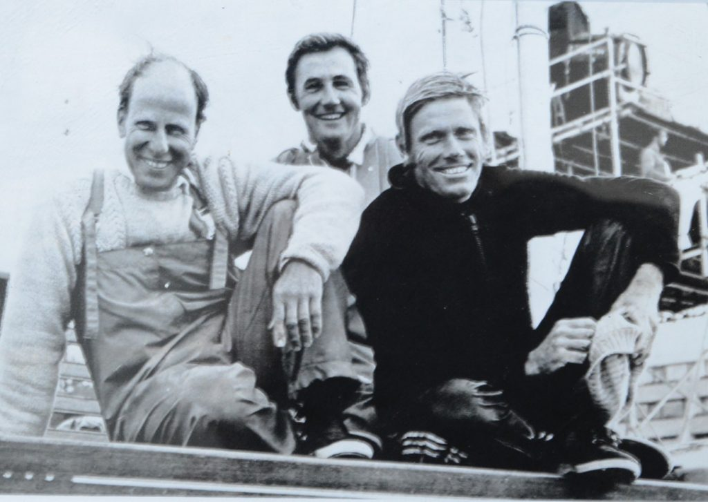 John Cuneo Tom Anderson and John Shaw return to shore having won the Olympic gold medal.