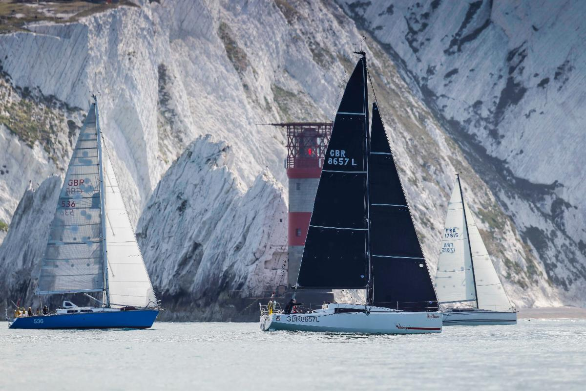 Yachts pass the Needles as they race round the Isle of Wight © Paul Wyeth/pwpictures.com