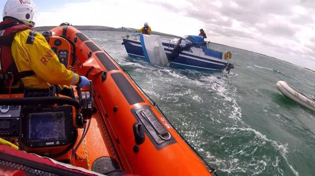 Poole lifeboat assists a dismasted yacht. Photo Poole RNLI.