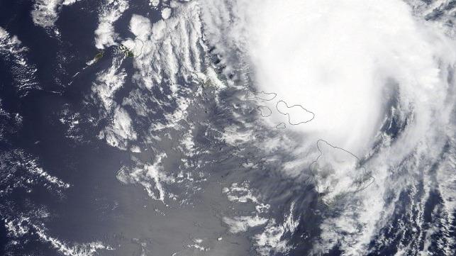 Hurricane Douglas passes by Maui on a westward track