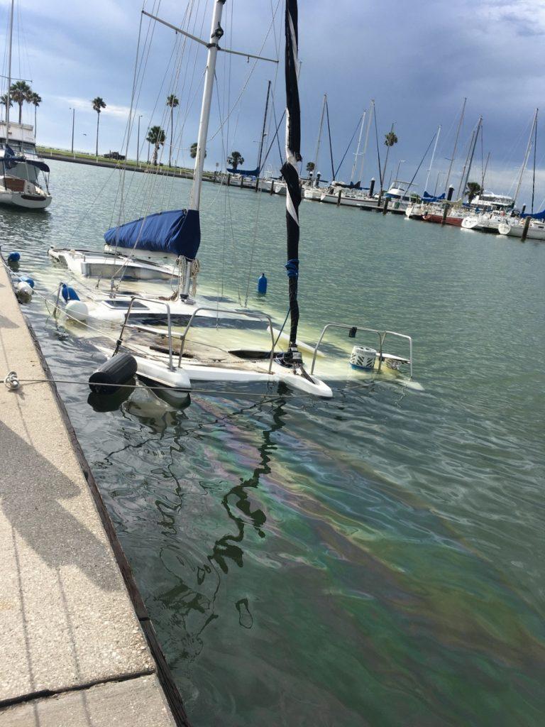 A catamaran sunk by TS Hanna. Photo USCG.