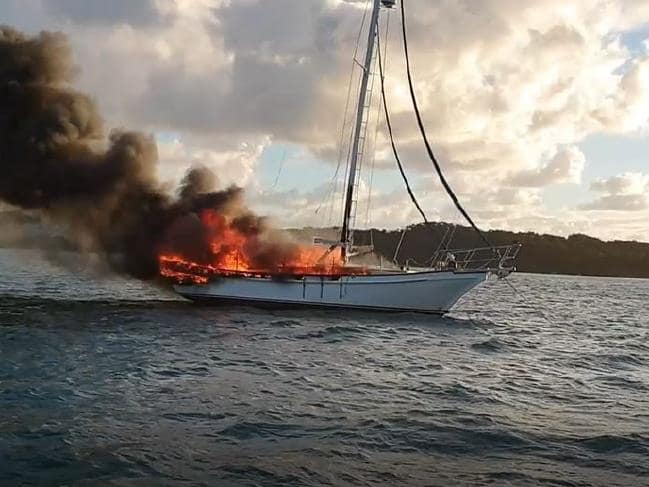 Yacht on fire off Moreton Island. Photo Queensland Police.