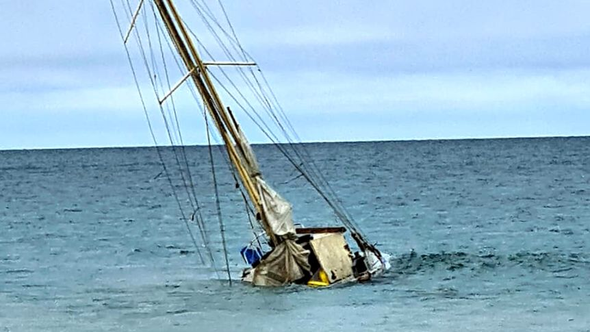 The yacht now rests on the sand just metres from the shore at North Haven Beach.(Supplied: Ella Mayward)