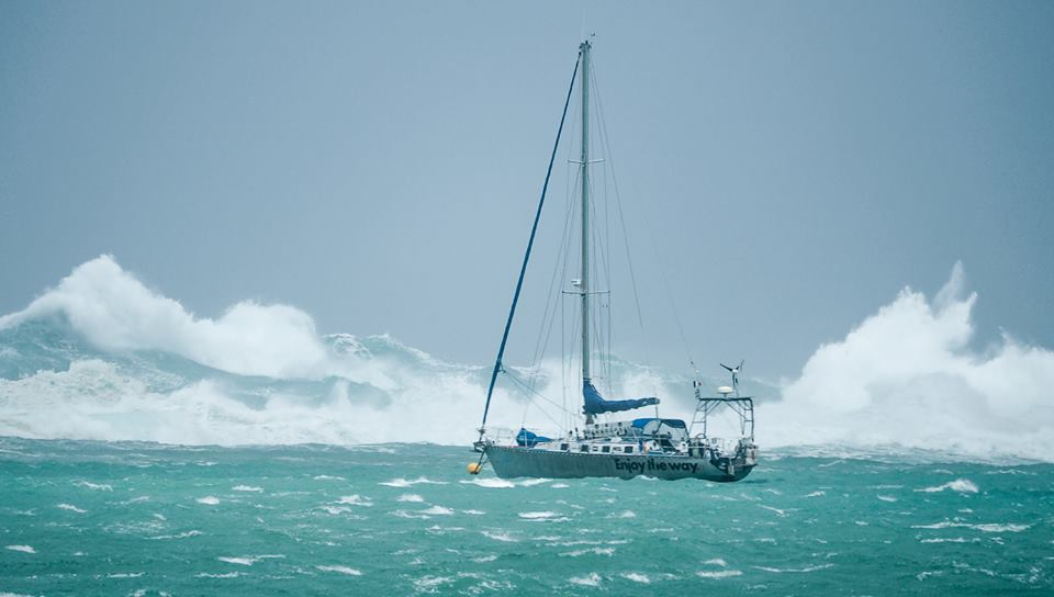 Surf pounding over the reef with the boat on the mooring beside us.