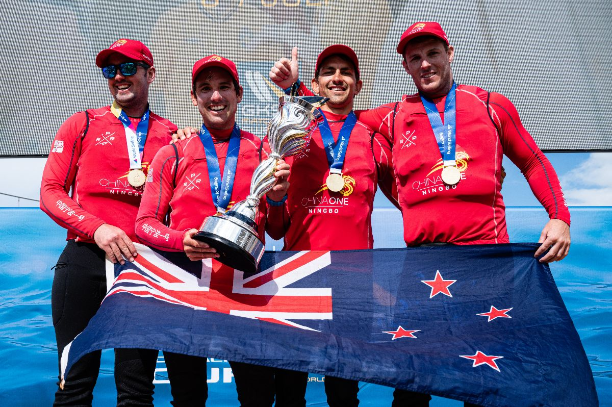 Skipper Phil Robertson (second from left) and crew are all smiles after winning the 2019 Open Match Racing World Championship (©Drew Malcolm/ChinaOne.Ningbo photo).