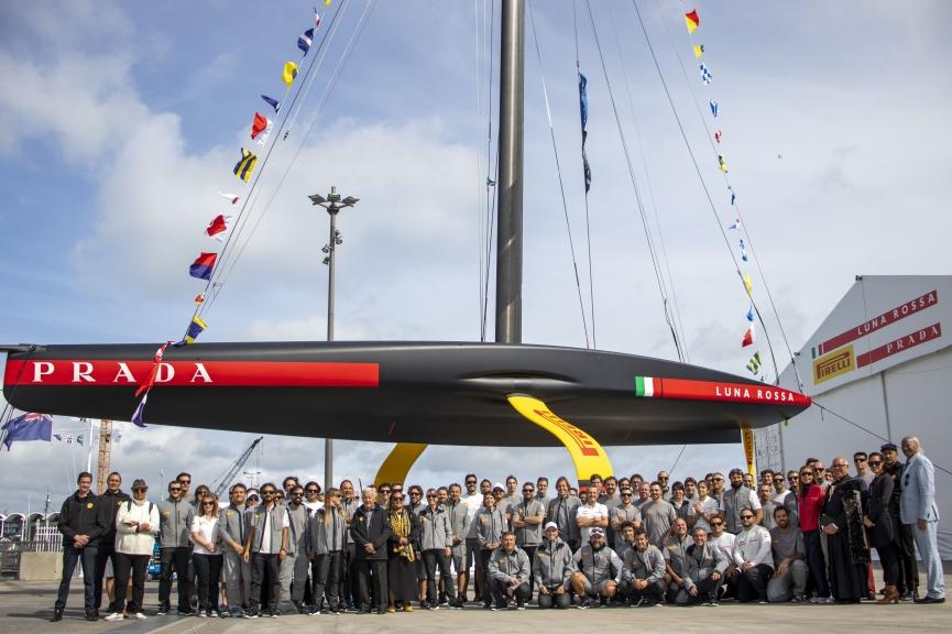 Luna Rossa team with their race boat. Photo Credit: Luna Rossa Prada Pirelli Team.