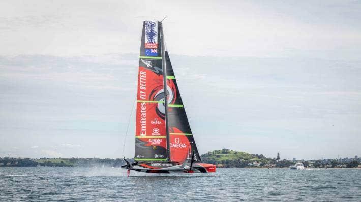 Team New Zealand's Te Rehutai rips past North Head. Photo Emirates Team New Zealand.
