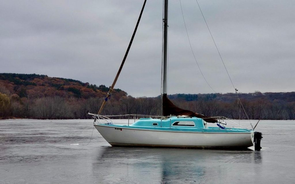 This sailboat is in danger of becoming locked into the frozen St. Croix River at the Boom Site Landing north of Stillwater. Greg Seitz via Twitter.