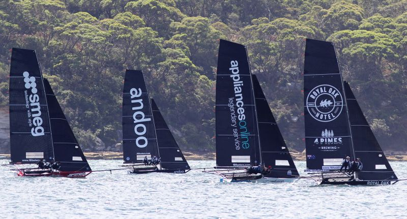 Classic battle to the windward mark. Photo Michael Chittenden/18 Footers League.