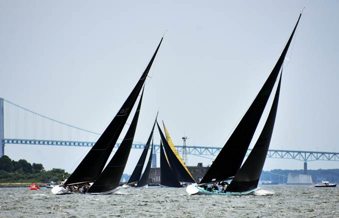 Enterprise (US-27) and Courageous (US-26) chasing the Grand Prix fleet to weather at the 2019 12mR World Championship in Newport, Rhode Island. Photo credit: SallyAnne Santos