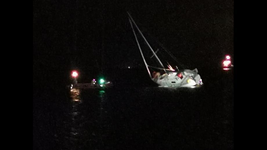 Troon D class inshore lifeboat alongside the yacht. Photo Ayr Coastguard Rescue Team.