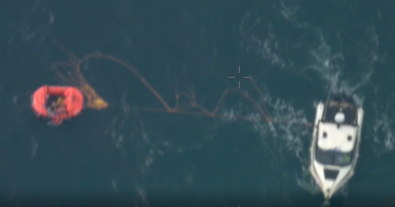 Search and Rescue approaches the liferaft. Screenshot from AMSA video.